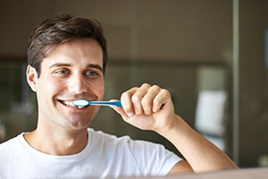 Man brushing teeth to prevent dental emergencies